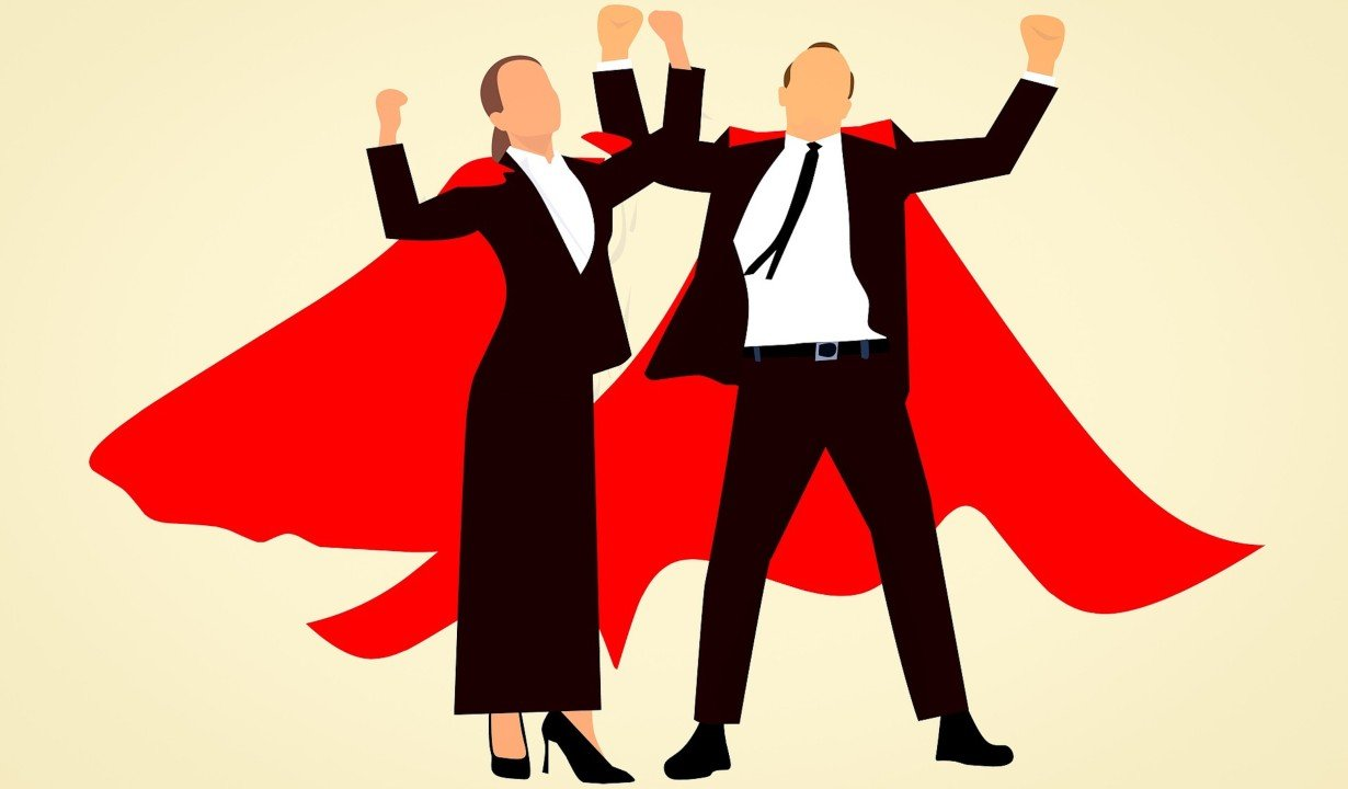 Two People WIth Red Capes